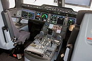 Airbus exhibition stand showing full-scale A350 XWB cockpit mock-up at the Farnborough Air Show, England. The A350 XWB is the only all-new aircraft in the 300-400 seat category. The A350 XWB is a family of long-range, two-engined wide-body jet airliners developed by European aircraft manufacturer Airbus. The A350 is the first Airbus with both fuselage and wing structures made primarily of carbon-fiber-reinforced polymer. It's scheduled to enter commercial service later in 2014.