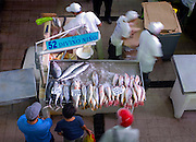 Customers wait for their fresh fish at the Fish Market (El Mercardo del Marisco) in the Casco Viejo neighborhood of Panama City, Panama.