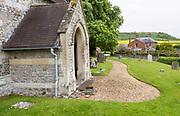 Huish church farmhouse and chalk scarp slope, Manor Farm, Huish, Vale of Pewsey, Wiltshire, England, UK