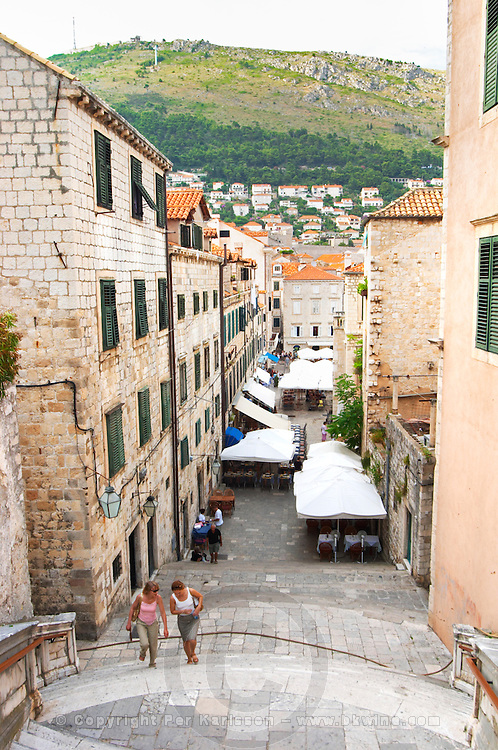 View of the Uz Jezuite stairs down to the city and the Gunduliceva Poljana Square. People walking up the steep stairs Dubrovnik, old city. Dalmatian Coast, Croatia, Europe.