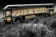 Abandoned junk bus somewhere along the Colorado Highway with a bright abstract interior.