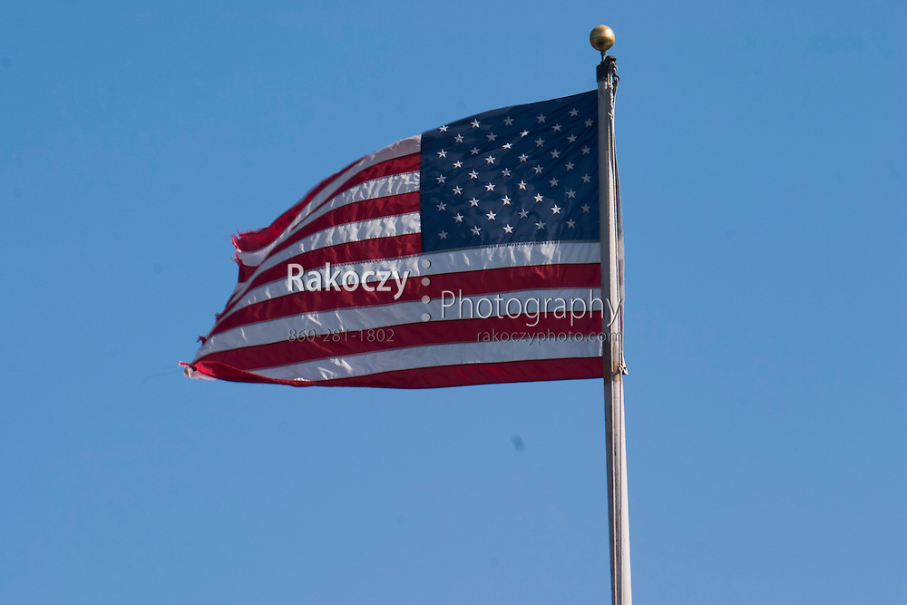 An American flag waves in the breeze.
