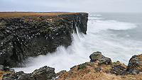 Waves brake on the cliffs at Arnarstapi, Snæfellsnes Peninsula, West Iceland.