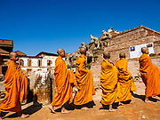 12 MARCH 2017 - BHAKTAPUR, NEPAL:  Buddhist monks from Southeast Asia walk through Durbar Square in Bhaktapur, Nepal.    PHOTO BY JACK KURTZ