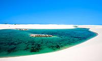 view of lagoa azul in desert white sand dunes of the Lencois Maranheses National Park in brazil