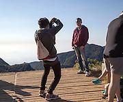 Tourists taking photos at the edge of World's End cliff at Horton Plains national park, Sri Lanka, Asia