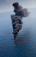 6-10-2010. Skimmer boats collect  bp oil of the surface of the Gulf of Mexico and then do a control burn.