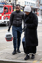 """© Licensed to London News Pictures. 16/11/2019. Bolton, UK. A pet cage is carried away from the site of the blaze . Firefighters work at the scene where a fire broke out overnight (15th/16th November 2019) at a block of flats known as """" The Cube """" , in Bolton Town Centre . At least two people are known to have been treated by paramedics at the scene of the six-story block , which is occupied by students of the University of Bolton . Photo credit: Joel Goodman/LNP"""