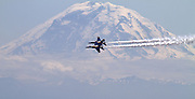The Navy Blue Angels practice over Lake Washington as Mt. Rainier looms in the distance. (Mike Siegel / The Seattle Times)