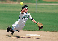 Slug:  soft22a.Photo by: Michael Burke.Size:  57p7 x 6.87.Caption: Shasta College Shortstop Danielle Ferris throws towards first base against College of The Redwoods in the 5th inning of the first game that the Knights went on to win.