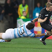 England Chris Ashton is tackled by Argentina centre Gonzalo Tiesi during the England V Argentina, Pool B match during the Rugby World Cup in Dunedin, New Zealand,. 10th September 2011. Photo Tim Clayton