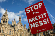 A pro-EU 'Stop This Brexit Mess' placard and the UK Houses of Parliament during the continuing protest against Brexit, on 19th February 2019, in London, England.