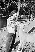 Octavia Hirschman with deer in campground, Colorado.