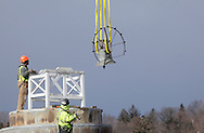 Two workers watch as a crane removes the bell from the top of Orange County's historic 1841 Courthouse in Goshen on Wednesday Jan. 4, 2011. The bell, bell tower and cradle were removed and the roof sealed to stop the leaks which had been damaging the inside of the building.