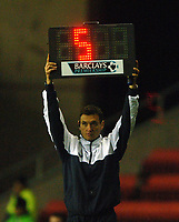 Photo: Paul Greenwood.<br />Wigan Athletic v Sheffield United. The Barclays Premiership. 16/12/2006.  The Fourth Official Mr A Marriner shows 5 minutes of added time