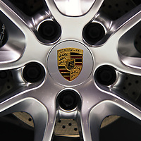 """""""Porsche Wheel""""<br /> <br /> An awesome image of a Porsche wheel! Beautifully detailed with the colorful Porsche logo!!<br /> <br /> Cars and their Details by Rachel Cohen"""
