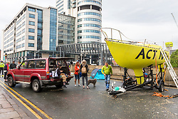 © Licensed to London News Pictures. 19/07/2019. Leeds UK. Extinction Rebellion activist's pack up in Leeds this morning on the fifth day of the protest. Activist's have blocked Victoria Bridge in the city centre with a boat & tents. The protest is part of Extinction Rebellion's 'summer uprising' campaign, which has seen similar blockades in London, Cardiff, Bristol and Glasgow & is expected to last until Friday.Photo credit: Andrew McCaren/LNP