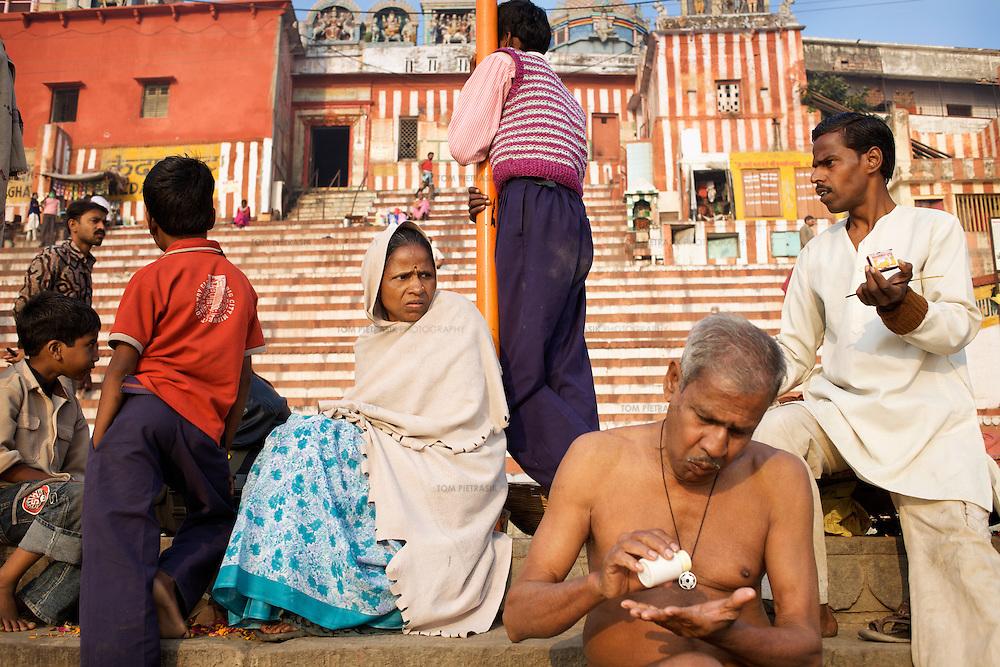 Hindu pilgrims gather at the banks of the Ganges river at the holy city of Varanasi, also known as Benares...Photo: Tom Pietrasik.Varanasi, Uttar Pradesh, India.February 2nd 2010