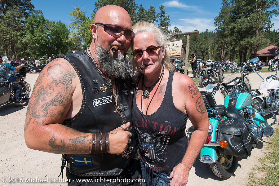 Cat Hammes, the one-legged Blonde with Tom Wolf of Sweden on a stop at the Nemo Guest Ranch on the Annual Cycle Source and Michael Lichter Rides (combined this year) left from the new Broken Spoke area of the Iron Horse Saloon during the Sturgis Black Hills Motorcycle Rally. SD, USA.  Wednesday, August 10, 2016.  Photography ©2016 Michael Lichter.