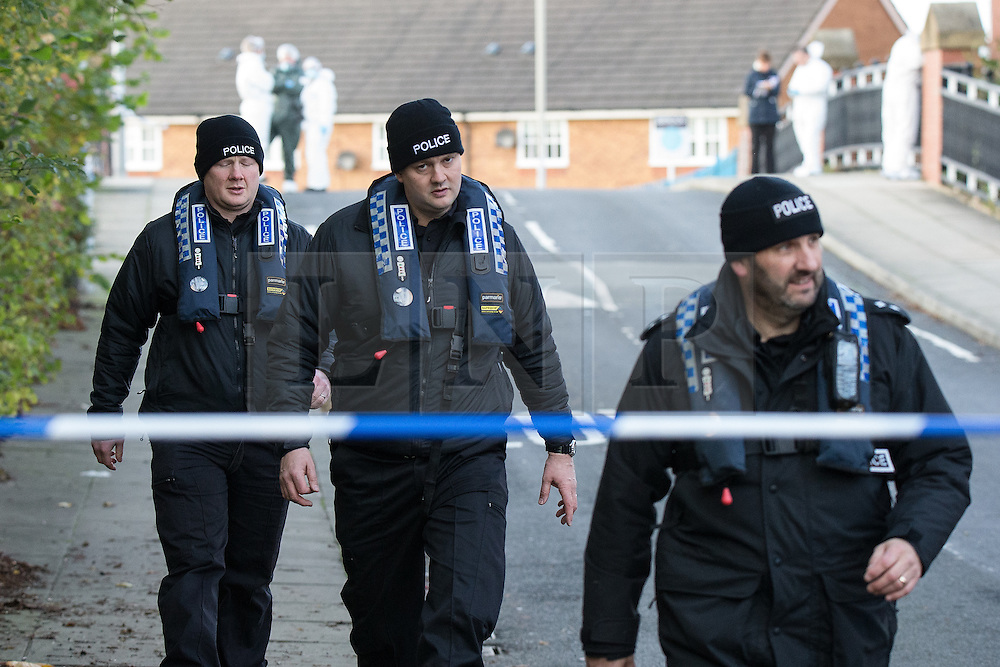 © Licensed to London News Pictures . 16/11/2015 . Liverpool , UK . An underwater search team at the scene by the Leeds-Liverpool Canal in the Eldonian Village area of Liverpool where a 16 year old boy was shot dead last night (15th November 2015 ) . Photo credit: Joel Goodman/LNP