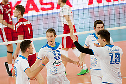 Tine Urnaut #13 of Slovenia during volleyball match between National teams of Slovenia and Poland in 4th Qualification game of CEV European Championship 2015 on May 23, 2014 in Arena Stozice, Ljubljana, Slovenia. Photo by Urban Urbanc / Sportida