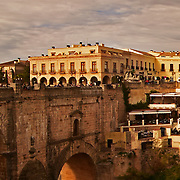 """Crop to show detail of image.<br /> <br /> Very large panorama of Ronda (Spanish pronunciation:[ˈronda]) is a city in the Spanish province of Málaga. It is located about 100 kilometres (62mi) west of the city of Málaga, within the autonomous community of Andalusia. Its population is approximately 35,000 inhabitants.<br /> Around the city are remains of prehistoric settlements dating to the Neolithic Age, including the rock paintings of Cueva de la Pileta. Ronda was however first settled by the early Celts, who, in the 6th century BC called it Arunda. Later Phoenician settlers established themselves nearby to found Acinipo, known locally as Ronda la Vieja, Arunda or Old Ronda. The current Ronda is however of Roman origins,[1] having been founded as a fortified post in the Second Punic War, by Scipio Africanus. Ronda received the title of city at the time of Julius Caesar.<br /> In the 5th century AD Ronda was conquered by the Suebi, led by Rechila, being reconquered in the following century by the Eastern Roman Empire, under whose rule Acinipo was abandoned. Later the Visigoth king Leovigild captured the city. Ronda was part of the Visigoth realm until 713, when it fell to the Arabs, who named it Hisn Ar-Rundah (""""Castle of Rundah"""") and made it the capital of the Takurunna province."""