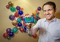 John Mastrototaro, a scientist at Medtronic, shows off the latest insulin pump that is getting closer to the functions of an artificial pancreas in front of a sculpture of insulin secreting beta cells. Shot at the facility in Northridge, CA. July 9, 2013. Photo by David Sprague ©2013