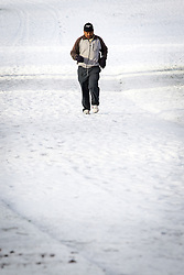 © Licensed to London News Pictures . 26/01/2013 . Salford , UK . A man jogs through the freshly fallen snow . People enjoy fresh overnight snow this morning (26th January 2013) in Buile Hill Park , Salford . Photo credit : Joel Goodman/LNP