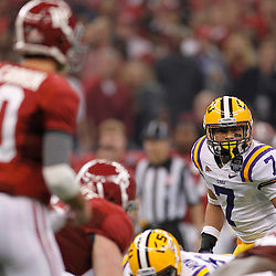 Jan 9, 2012; New Orleans, LA, USA; LSU Tigers cornerback Tyrann Mathieu (7) eyes the line of scrimmage against the Alabama Crimson Tide during the first half of the 2012 BCS National Championship game at the Mercedes-Benz Superdome.  Mandatory Credit: Derick E. Hingle-US PRESSWIRE