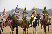 Costumed revelers ride on horseback during the traditional Cajun Courir de Mardi Gras chicken run February 15, 2015 in Church Point, Louisiana. The event involves 900-hundred costumed revelers competing to catch a live chickens as they move from house to house throughout the rural community.
