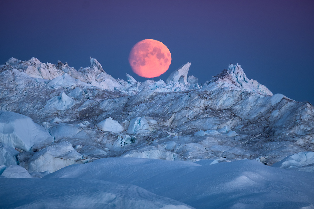 I've been organising photography tours to Greenland for a few years now. Every time I go to Greenland it's like landing on another planet, where time flows at a different pace and Day and Night are sometimes confused about their duties.