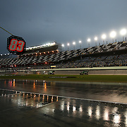 Rain continues to fall as the track workers try to dry the front stretch prior to the 56th Annual NASCAR Coke Zero400 race at Daytona International Speedway on Saturday, July 5, 2014 in Daytona Beach, Florida.  (AP Photo/Alex Menendez)