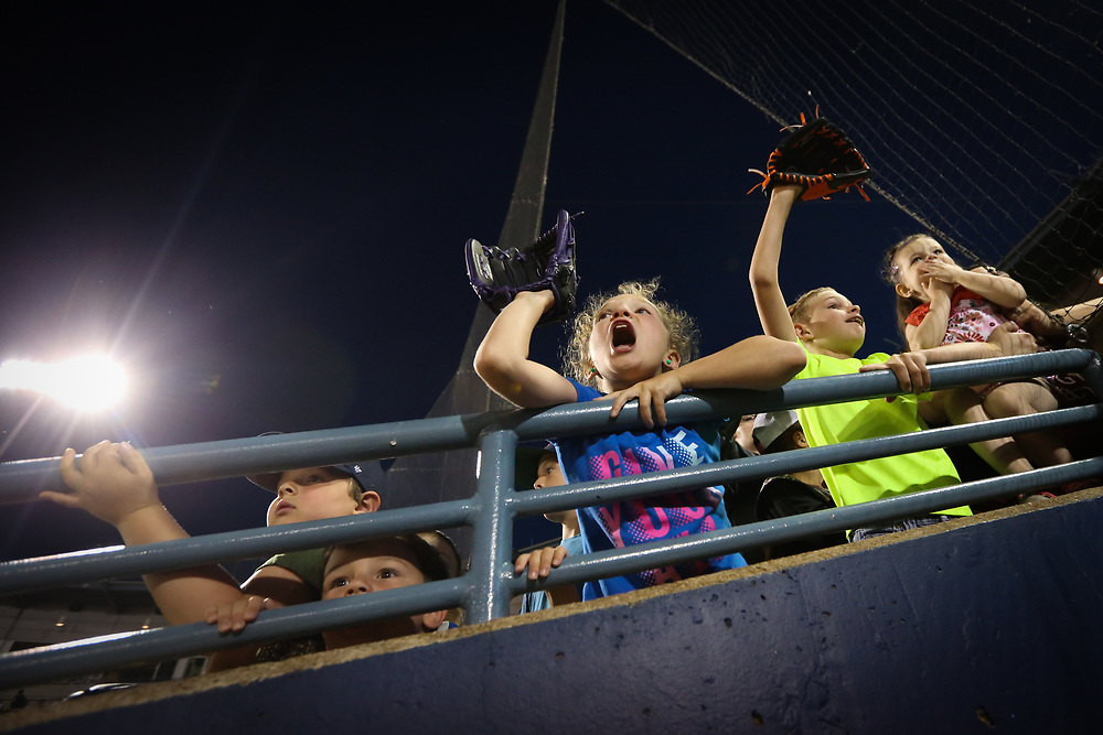 Young Toledo Mud Hens fans call out to players for autographs after the team lost their game against the Louisville Bats on June 15, 2018.