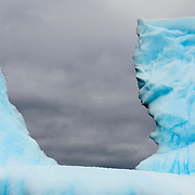 An iceberg with sharp jagged shapes in Antarctica.