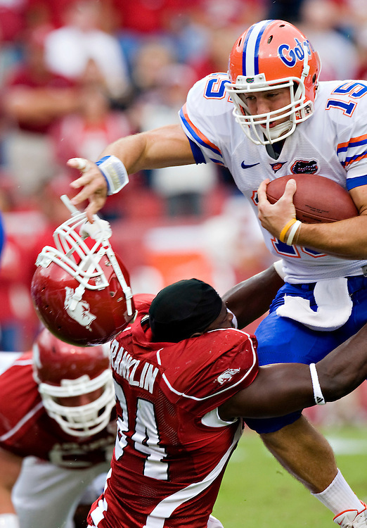 FAYETTEVILLE, AR - OCTOBER 4:   Tim Tebow #15 of the Florida Gators knocks off the helmet of Jerry Franklin #34 of the Arkansas Razorbacks at Donald W. Reynolds Stadium on October 4, 2008 in Fayetteville, Arkansas.  The Gators defeated the Razorbacks 38 to 7.  (Photo by Wesley Hitt/Getty Images) *** Local Caption *** Tim Tebow