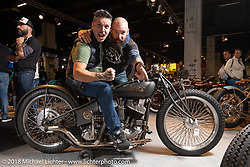 Abnormal Cycles' Samuele Reali with his 1940 Harley-Davidson flathead custom in the AMD World Championship of Custom Bike Building in the Intermot Customized hall during the Intermot International Motorcycle Fair. Cologne, Germany. Sunday October 7, 2018. Photography ©2018 Michael Lichter.