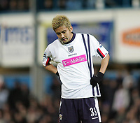 Photo: Lee Earle.<br /> Portsmouth v West Bromwich Albion. The Barclays Premiership. 17/12/2005. West Brom's Junichi Inamoto looks dejected after yet another away defeat.