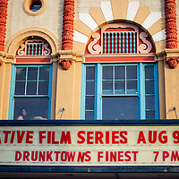 """080914       Cable Hoover<br /> <br /> Film director Charmaine Jackson watches from the window of El Morro Theatre as a crowd lines up for the preview of her film """"Drunktown's Finest"""" during ArtsCrawl Saturday in downtown Gallup."""