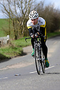 United Kingdom, Finchingfield, Mar 27, 2010:  Erron Field, Chelmer CC, approaches the 4 miles to go marker during the 2010 edition of the 'Jim Perrin' Memorial Hardriders 25.5 mile Sporting TT promoted by Chelmer Cycling Club. Copyright 2010 Peter Horrell.