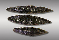 Black obsidian blades. Catalhoyuk Collections. Museum of Anatolian Civilisations, Ankara. Against a grey background .<br /> <br /> If you prefer you can also buy from our ALAMY PHOTO LIBRARY  Collection visit : https://www.alamy.com/portfolio/paul-williams-funkystock/prehistoric-neolithic-art.html - Type Catalhoyuk into the LOWER SEARCH WITHIN GALLERY box. Refine search by adding background colour, place, museum etc.<br /> <br /> Visit our PREHISTORIC PLACES PHOTO COLLECTIONS for more  photos to download or buy as prints https://funkystock.photoshelter.com/gallery-collection/Prehistoric-Neolithic-Sites-Art-Artefacts-Pictures-Photos/C0000tfxw63zrUT4