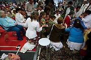 Een bezoeker ondergaat de darshan, oftewel omhelzing van Amma. In de Expo in Houten is Mata Amritanandamayi, beter bekend als Amma of 'hugging mother', aanwezig om mensen te omhelzen en te inspireren. Het driedaags benefiet in Houten is het grootste spirituele festival in Nederland en zal naar verwachting 15.000 bezoekers trekken.<br /> <br /> A visitor is receiving the darshan from Amma. In the Expo in Houten people are gathering to get a darshan, or hug, by  Mata Amritanandamayi, also known as Amma or 'hugging mother'. Amma is travelling through the world to hug people for inspiring them to make a better world. Amma is one of the twelve most influence spiritual leaders of the world. The event in Houten lasts for three days and is the biggest spiritual event of The Netherlands.