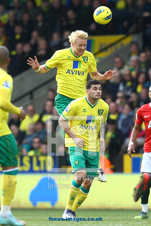Picture by Paul Chesterton/Focus Images Ltd.  07904 640267.26/02/12.Zac Whitbread of Norwich heads clear during the Barclays Premier League match at Carrow Road Stadium, Norwich.