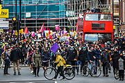 """People hold banners and placards during a """"Kill the Bill"""" demonstration as they march towards Home Office in central London on Saturday, May 1st, 2021. (Photo/ Vudi Xhymshiti)"""