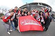 a Group of  Arsenal fans from Hong Kong pose outside the Emirates Stadium before k/o. Barclays Premier league match, Arsenal v Crystal Palace at the Emirates Stadium in London on Sunday 17th April 2016.<br /> pic by John Patrick Fletcher, Andrew Orchard sports photography.