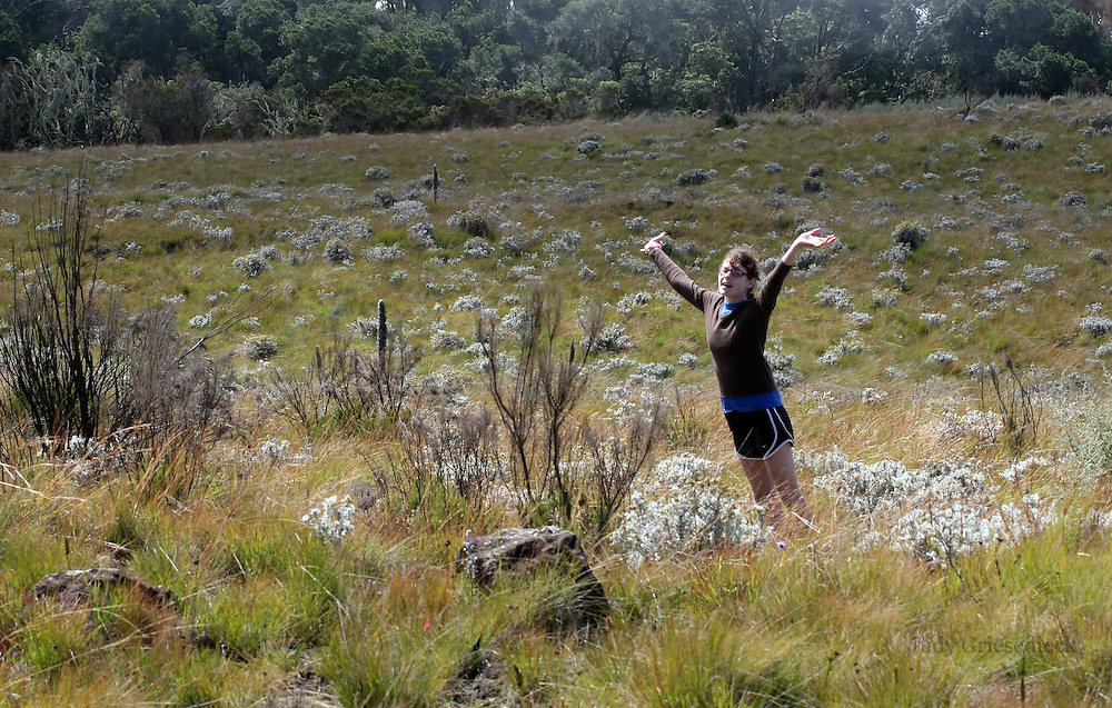 Kate Wackett of St. Paul, MN, takes in the beauty of the meadows on her way up Mt. Kilimanjaro.