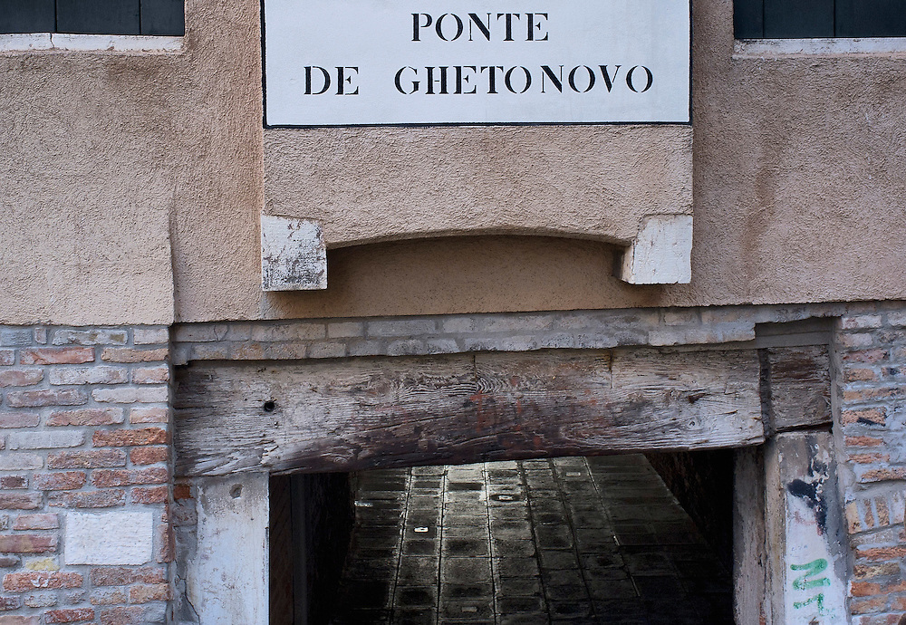 VENICE, ITALY - NOVEMBER 15:  A sign displayed on a wall shows the way to the bridge of the Old Ghetto on November 15, 2011 in Venice, Italy. Established in 1516 the Ghetto of Venice was the area were Jews were compelled to live during the Venetian Republic. The English term 'ghetto' is derived from the Venetian term for 'slag' and refers to the refuse left the foundry that was located on the same island. In present times the ghetto is a multi-ethnical area area seen as the cultural heart of the city, but with five synagogues remains the centre of the of Jewish community.