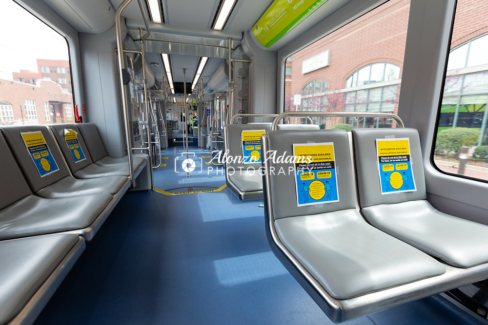 Signs on Oklahoma City Streetcars advise riders to practice social distancing by not allowing riders to sit too close on the cars on Saturday, March 21, 2020. Photo copyright © 2020 Alonzo J. Adams.