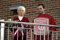 25 September 2010: Mrs. Weisbecker, widow of Milt Weisbecker accepts a plaque commemorating a name change in a scholarship program to honor her late husband and former Athletic Director at Illinois State from the current Athletic Director Sheahon Zenger.   The Missouri State Bears lost to the Illinois State Redbirds 44-41 in double overtime, meeting at Hancock Stadium on the campus of Illinois State University in Normal Illinois.