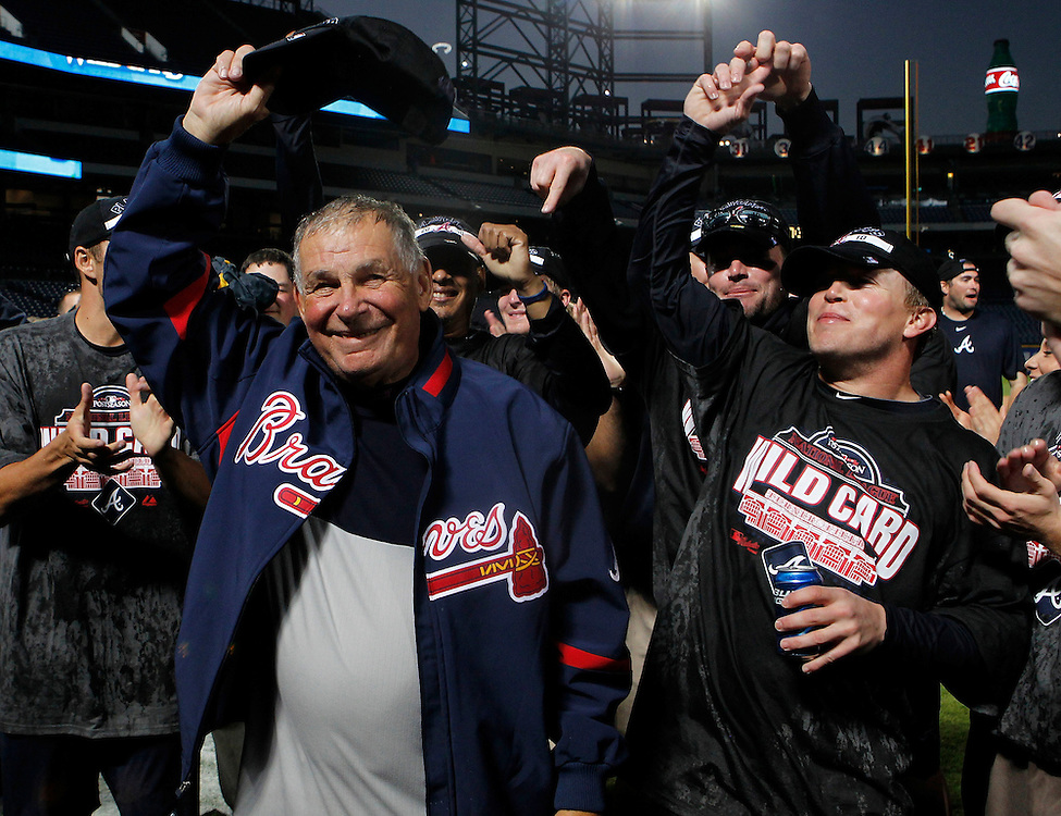 ATLANTA - OCTOBER 3:  Manager Bobby Cox #6 of the Atlanta Braves tips his cap to the crowd during the on-field wildcard celebration after the game against the Philadelphia Phillies at Turner Field on October 3, 2010 in Atlanta, Georgia.  (Photo by Mike Zarrilli/Getty Images)