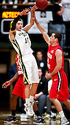 SHOT 1/28/12 3:19:04 PM - Colorado State's Wes Eikmeier #10 passes in front of San Diego State's James Rahon #11 during their regular season Mountain West conference game at Moby Arena in Fort Collins, Co. Colorado State upset 12th ranked San Diego State 77-60. (Photo by Marc Piscotty / © 2012)